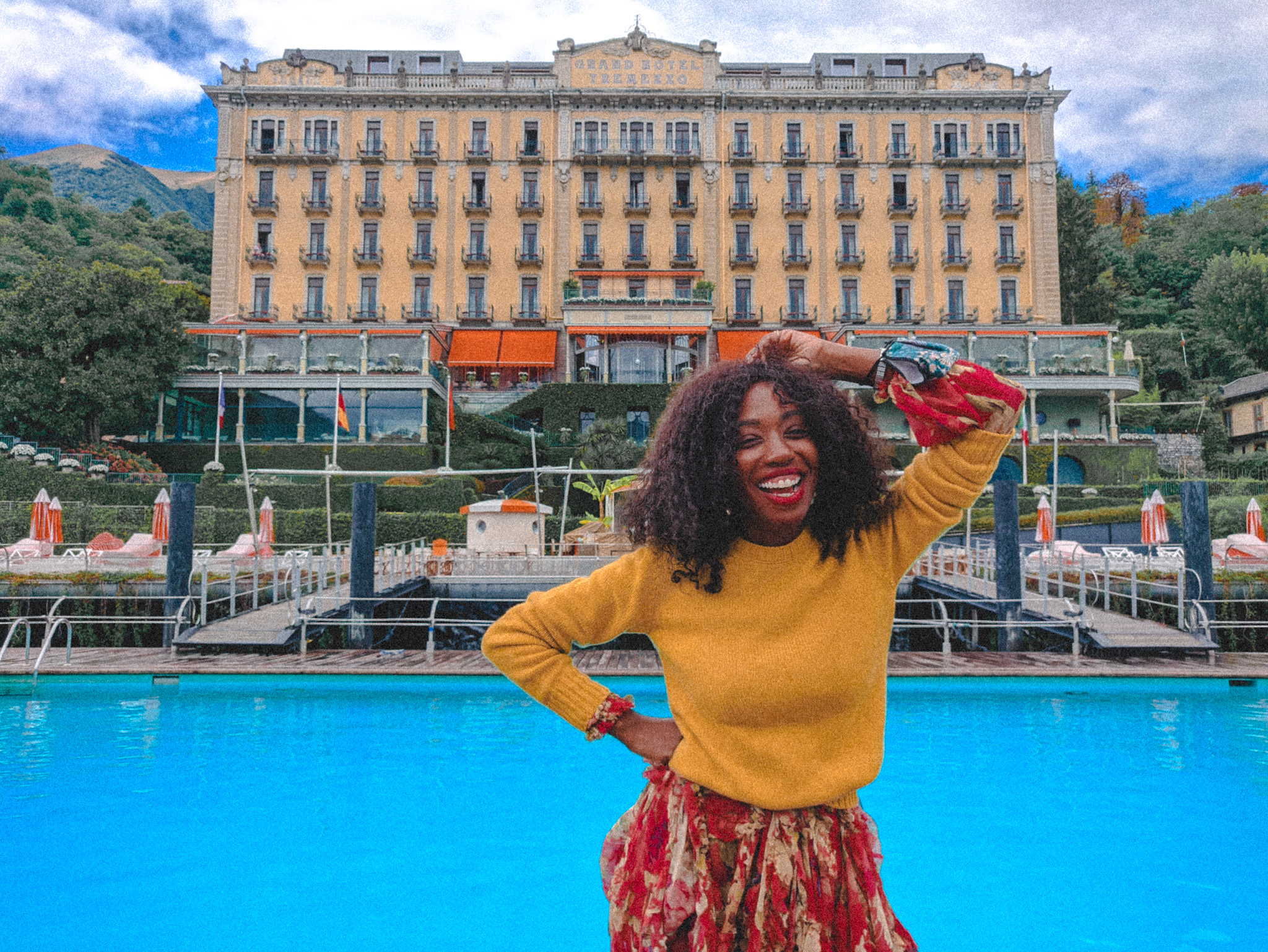 Nneya smiling in front of Grand Hotel Tremezzo baroque palace